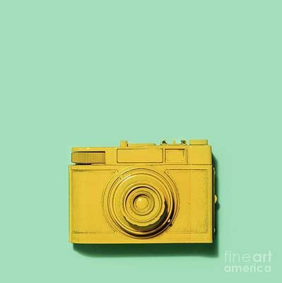 Photograph - Yellow Camera Laying On A Green Background by Michal Bednarek
