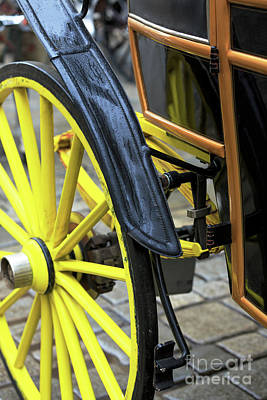 Photograph - Yellow Carriage Wheel by John Rizzuto