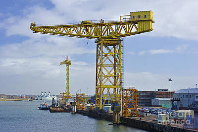 Barrow In Furness Wall Art - Photograph - Yellow Cranes. by Stan Pritchard