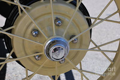 Hubcap Wall Art - Photograph - Yellow Ford Wheel Spokes by Heather Kirk