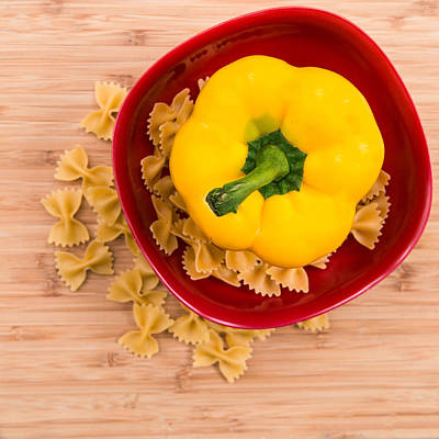Photograph - Yellow Pepper In Red Bowl With Pasta by Rebecca Cozart