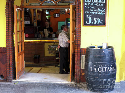 Photograph - Yellow Pub In Seville by John Rizzuto