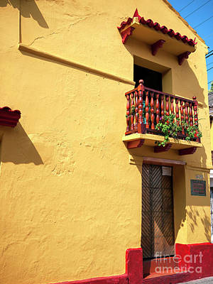 Photograph - Yellow Wall In Cartagena by John Rizzuto