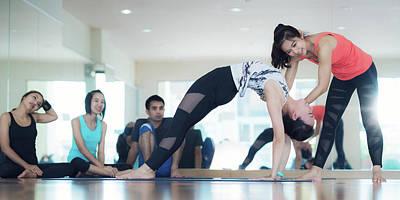 Photograph - Yoga Trainer Teach Yoga Student In Yoga Classroom by Anek Suwannaphoom