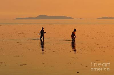 Photograph - Young Fishermen Searching For Fish by Christopher Shellhammer