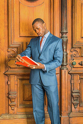 Photograph - Young African American Businessman Reading Book, Working In New  by Alexander Image