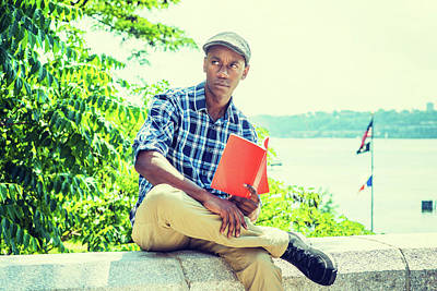 Photograph - Young African American Man Reading Red Book, Relaxing Outdoor In New York 1706189 by Alexander Image