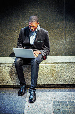 Photograph - Young African American Man Working On Laptop Computer Outside In by Alexander Image