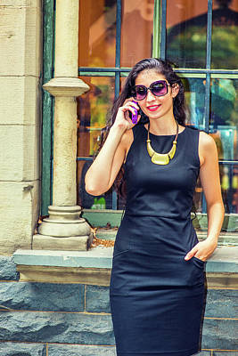 Photograph - Young American Businesswoman Talking On Cell Phone Outside by Alexander Image