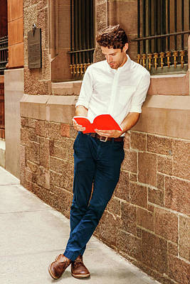 Photograph - Young American Man Reading Red Book Outside In New York 17052835 by Alexander Image