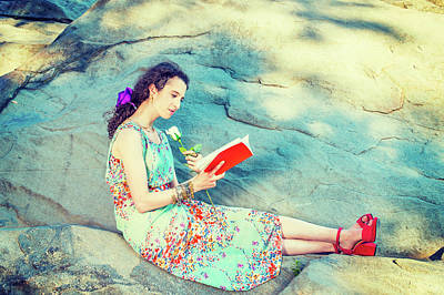 Photograph - Young American Woman Reading Book, Sitting On Rocks, Relaxing At by Alexander Image
