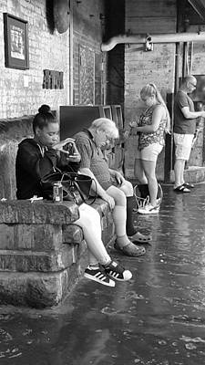 Photograph - Young And Old On A Bench B W by Rob Hans