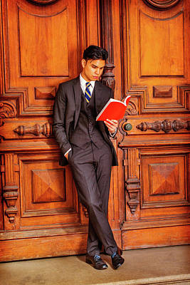 Photograph - Young Asian American Business Man Reading Book In New York by Alexander Image