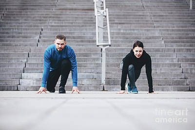Photograph - Young Athletic Couple In A Steady Position Crouching. by Michal Bednarek