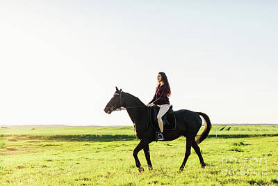 Photograph - Young Attractive Girl Riding On A Bay Horse. by Michal Bednarek