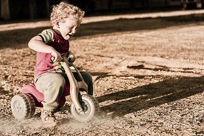 Young Boy Breaking At Fast Pace On Toy Bike Art Print by Jorgo Photography - Wall Art Gallery