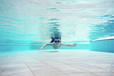 Photograph - Young Boy Swimming Underwater by Michal Bednarek