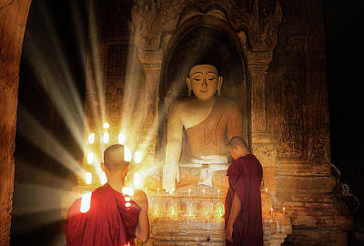 Young Buddhist Monk Are Reading With Sun Light Art Print by Anek Suwannaphoom