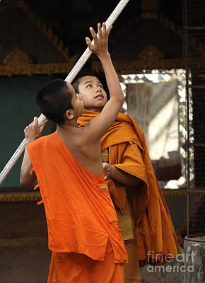 Photograph - Young Buddhist Monks Laos by Bob Christopher