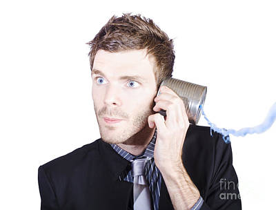 Listening Photograph - Young Businessman Listening To Telephone Can by Jorgo Photography - Wall Art Gallery