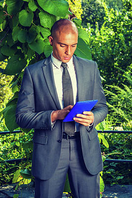Photograph - Young Businessman Working On Tablet Computer by Alexander Image