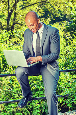 Photograph - Young Businessman Working Outside by Alexander Image