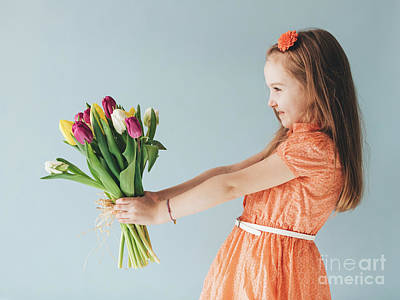 Photograph - Young Child Holding A Bunch Of Fresh Flowers by Michal Bednarek