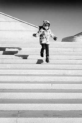 Photograph - Young Child Jumping Down Steps by John Williams