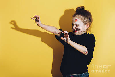 Photograph - Young Child With Cat Make Up Streching Her Hands by Michal Bednarek