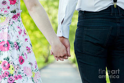 Husband Photograph - Young Couple In Love Holding Hands In Summer Park by Michal Bednarek
