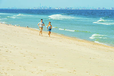 Photograph - Young Couple Running On Sandy Hook Beach, New Jersey, Usa by Alexander Image