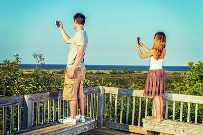Photograph - Young Couple Traveling, Video Recording With Cell Phone. by Alexander Image