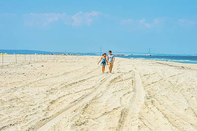 Photograph - Young Couple Walking, Talking, Relaxing On The Beach In New Jers by Alexander Image
