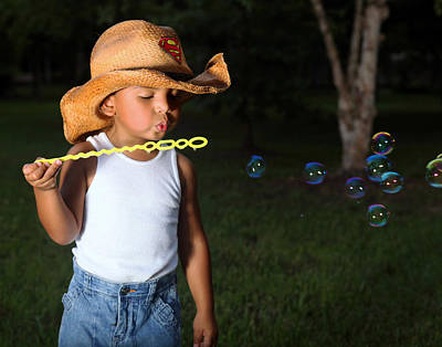 Young Cowboy Blowing Bubbles Art Print