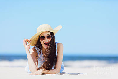 Photograph - Young Enthusiastic Girl Laying On The Beach, Smiling. by Michal Bednarek
