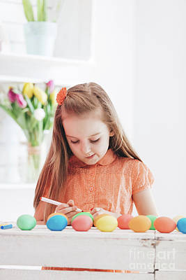 Photograph - Young Focused Girl Drawing Patterns On Dyed Eggs by Michal Bednarek