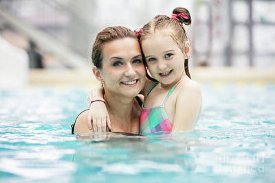 Photograph - Young Girl And Her Mother Hugging In The Pool. by Michal Bednarek