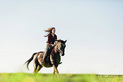 Photograph - Young Girl Dressed Casually Riding A Horse. by Michal Bednarek