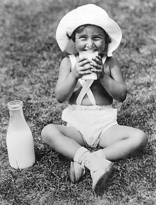 Milk Bottle Photograph - Young Girl Drinking Milk by Underwood Archives