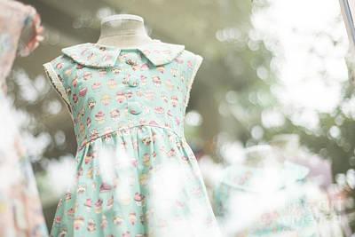 Photograph - Young Girl Fashion Dress In Childrenswear Fashion Shop Window by Jacek Malipan