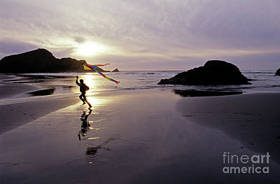 Photograph - Young Girl Flying Kite Om Beach by Jim Corwin