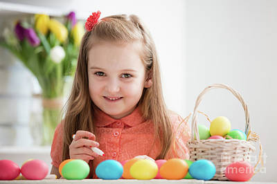Photograph - Young Girl Painting Eggs By The Desk, Smiling by Michal Bednarek