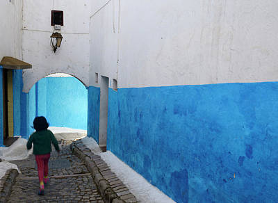 Rabat Photograph - Young Girl Running Along A Blue Alley Of Oudaia Kasbah Rabat Mor by Reimar Gaertner