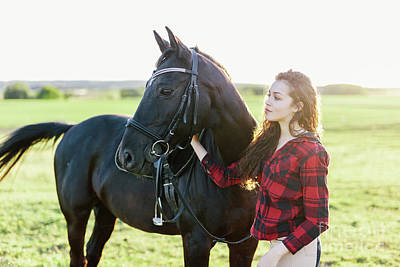 Photograph - Young Girl Standing Next To A Beautiful Dark Horse. by Michal Bednarek
