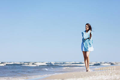 Photograph - Young Girl Walking By The Sea, Wrapped In A Blue Scarf. by Michal Bednarek