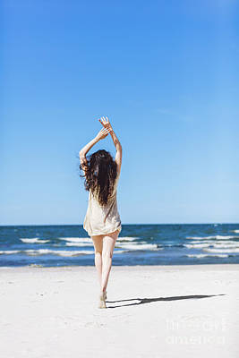 Photograph - Young Girl Walking On The Beach, Holding Her Hands Up. by Michal Bednarek
