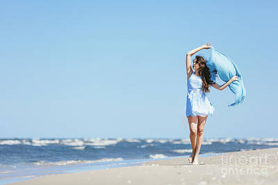 Photograph - Young Girl Walking On The Beach With Blue Scarf by Michal Bednarek