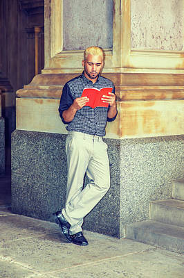 Photograph - Young Hispanic American Man Reading Book Outside. by Alexander Image