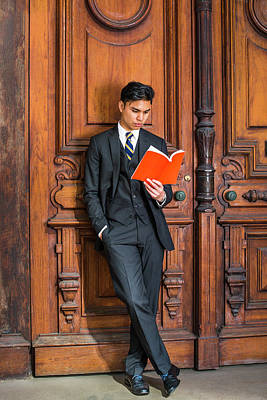 Photograph - Young Indonesian American Man Reading Book In New York by Alexander Image