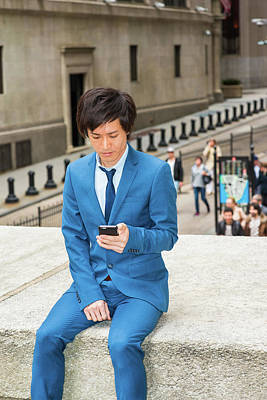 Photograph - Young Japanese Man Texting On Street 1504145 by Alexander Image